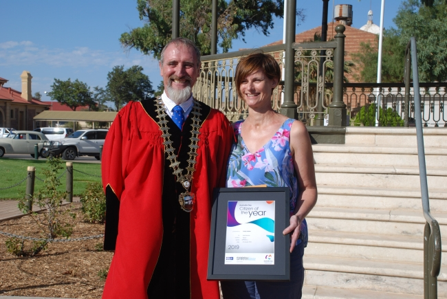 2019 Australia Day Citizen of the Year recipient Emily Holden standing with Mayor Brett Benbow and holding her certificate