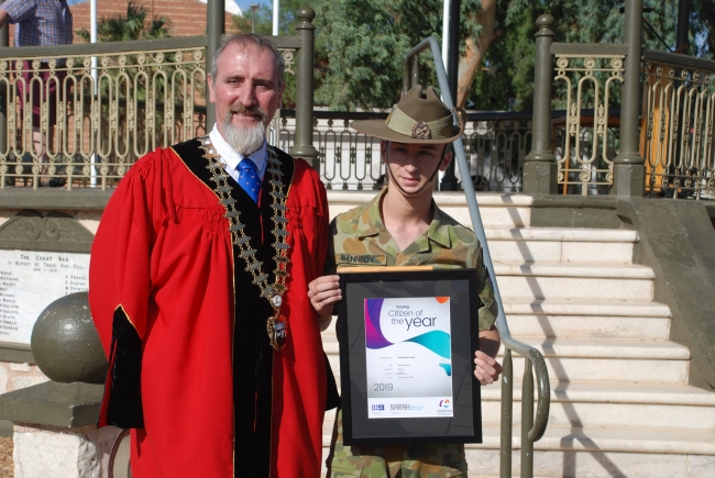 2019 Australia Day Young Citizen of the Year recipient Lennox Kennedy holding his certificate and standing with Mayor Brett Benbow