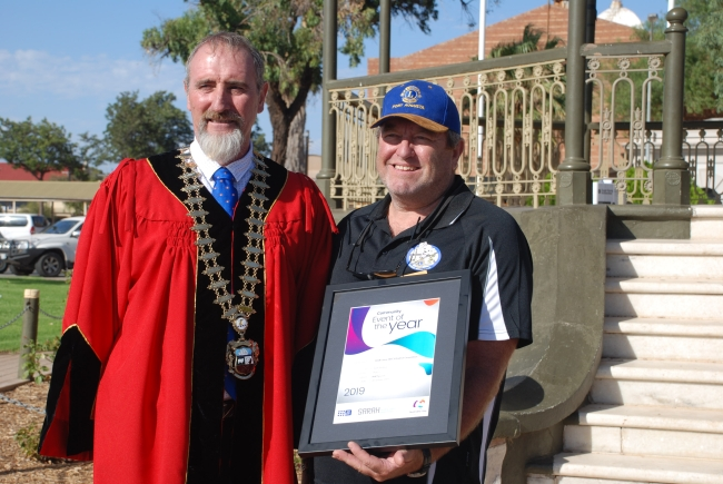 Club President Steve Fawcett representing the 2018 Lions 201C1 District Convention pictured holding the award certificate and standing with Mayor Brett Benbow